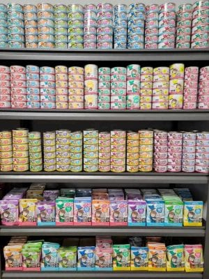 cans of pet food sitting on store shelves